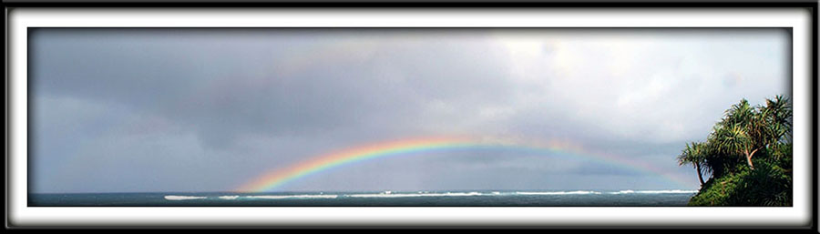 North shore Maui rainbow over ocean