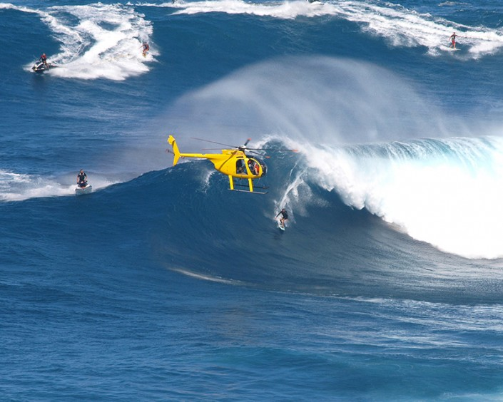 an image of big waves surf riders at Jaws on Maui, Hawaii