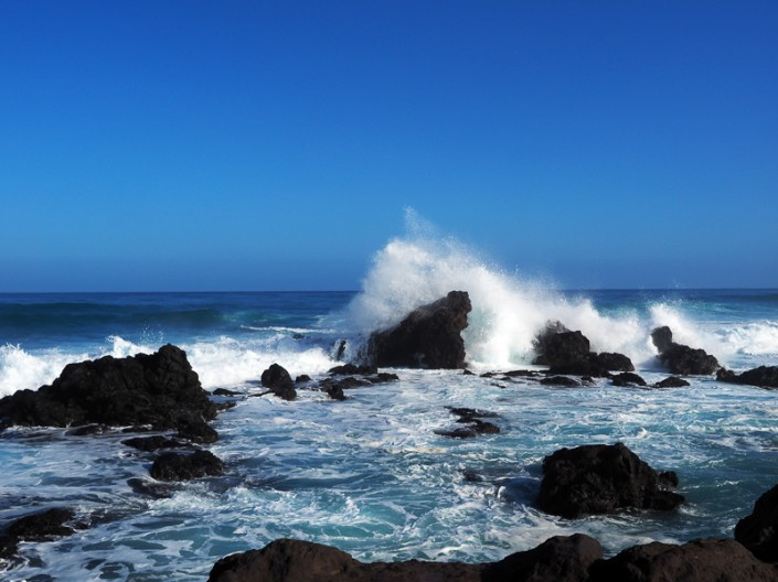 A view of the rough surf crashing against lava rock on Maui's north shore