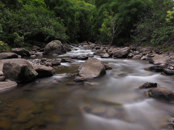A mid stream view of Iao Valley in the West Maui Mountains