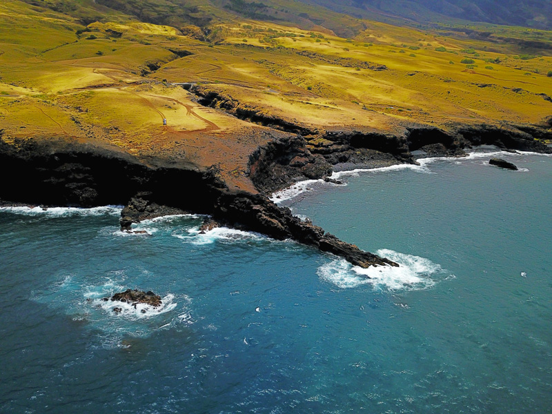 a wide angle aerial view of the pokowai sea arch