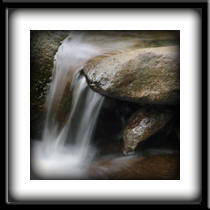 Hawaii Scenic Landscape Photography - close up image of a little water fall at Iao stream