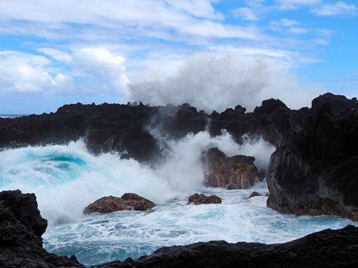 an image of wild surf crashing against the rocks at Wainapanapa State Park