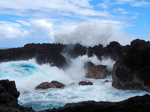 hawaii scenic gallery - an image of wild surf crashing against the rocks at Wainapanapa State Park