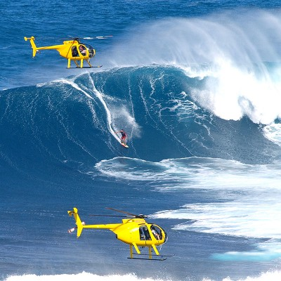 hawaii action gallery - a scene with two helicopters and a surfer at Jaws, Peahi, Maui, Hawaii