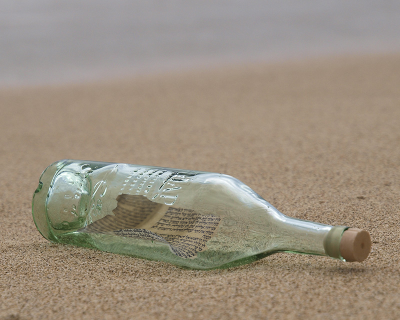 bottle on beach with note inside