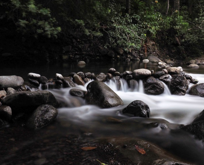 A wide angle view of the beautiful setting that is Iao Stream in Iao Valley State Park, Maui, Hawaii