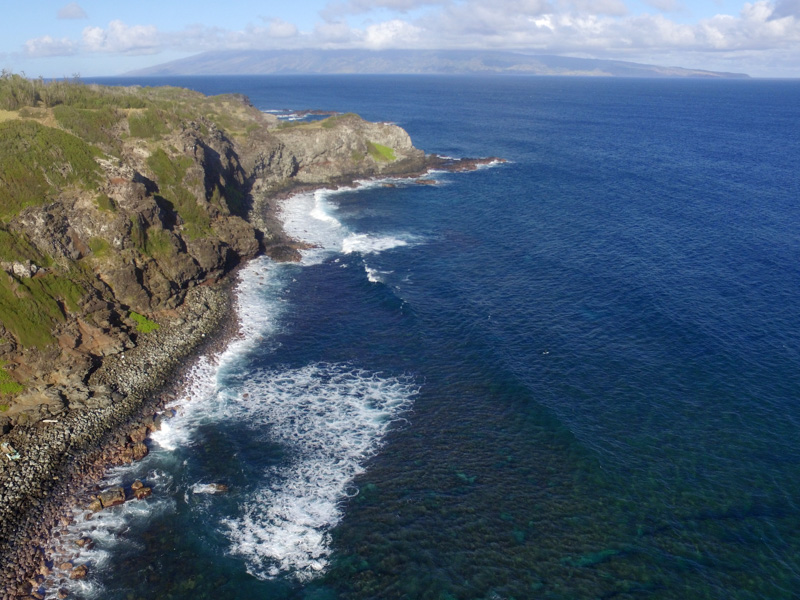 Rugged cliffs of scenic Northwest Maui with Molokai in the distance